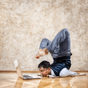 man-in-yoga-pose-with-computer-image-from-shutterstock