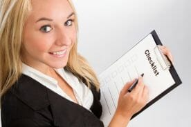 woman-holding-a-checklist-image-from-shutterstock