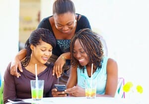 women-looking-at-smartphone-image-from-shutterstock