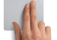 Using 2 fingers to click on a touchpad, image from Apple.com