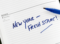 Image of desk calendar on Jan 1 with the notation New Year, Fresh Start