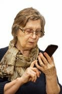 woman-with-glasses-looking-at-smartphone-image-from-shutterstock