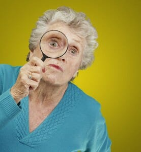 older-woman-looking-through-magnifying-glass-image-from-shutterstock
