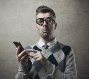frustrated-man-trying-to-press-smartphone-touchscreen-image-from-shutterstock