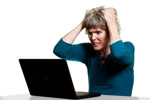 frustrated-woman-in-front-of-computer-image-from-shutterstock