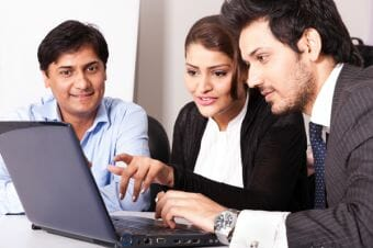 people-looking-at-laptop-screen-image-from-shutterstock