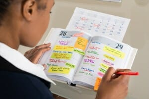 woman-looking-at-schedule-image-from-shutterstock