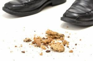 cookie-on-floor-broken-near-shoes-image-from-shutterstock